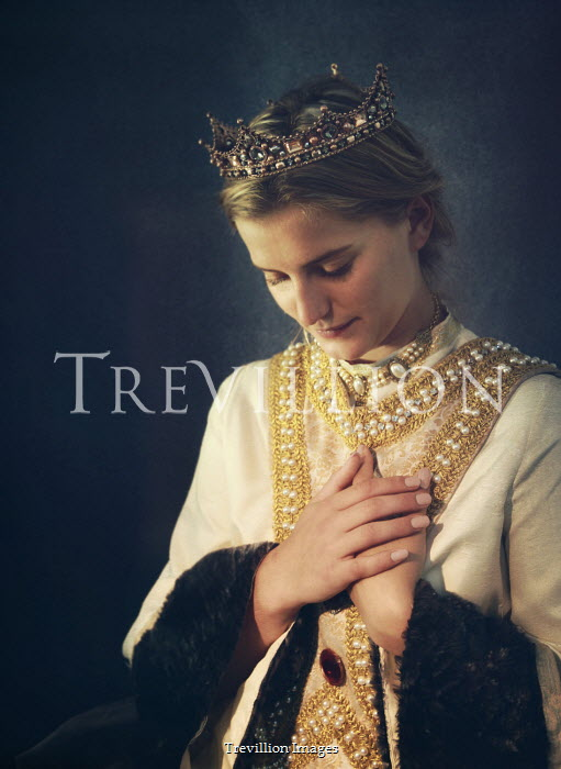Mark Owen Woman in medieval gown and crown with her hands on her chest