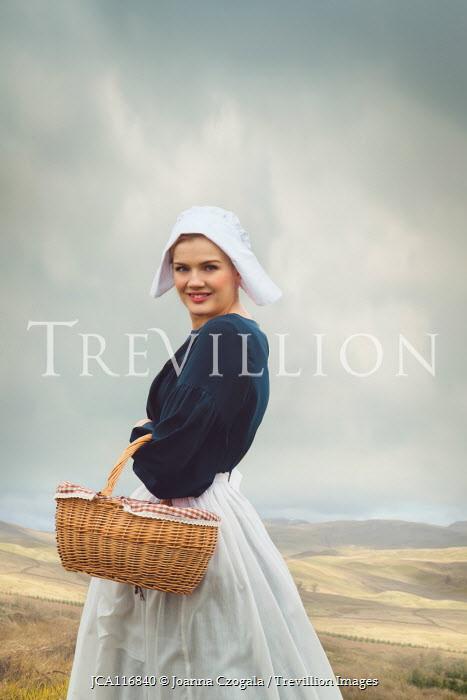 Joanna Czogala Victorian maid with basket in field