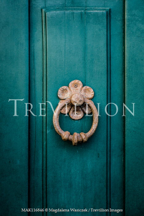 Magdalena Wasiczek decorative door knocker on old green door