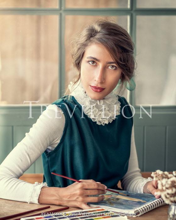 Anna Volynskaia Young woman painting at table