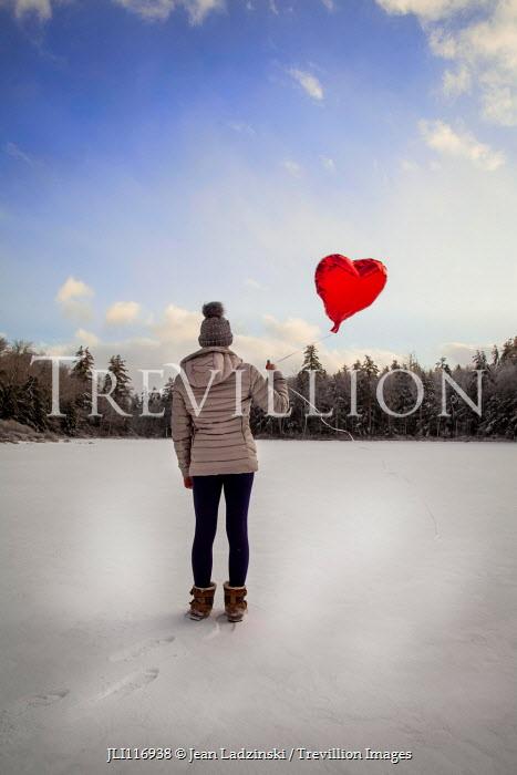 Jean Ladzinski GIRL HOLDING HEART-SHAPED BALLOON IN SNOW Children