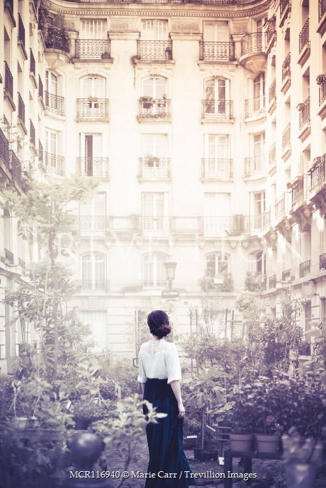 Marie Carr WOMAN STANDING IN COURTYARD OF APARTMENT BLOCK Women