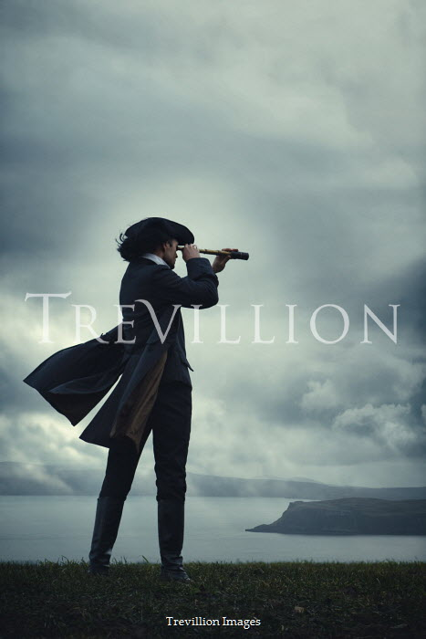 Magdalena Russocka historical man in tricorn hat and long jacket with telescope standing by sea