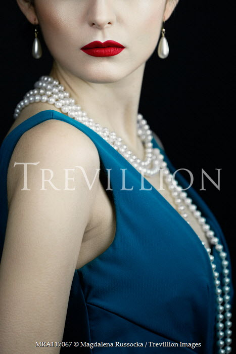 Magdalena Russocka close up of elegant woman with pearl necklace and earrings