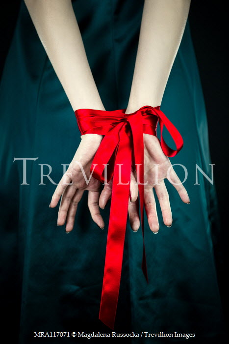 Magdalena Russocka womans hands tied with red ribbon