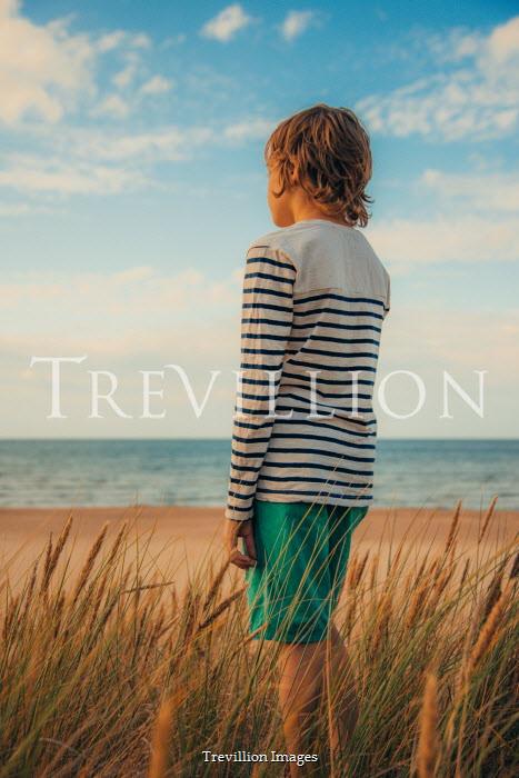 Katya Evdokimova BOY IN STRIPY TOP ON SANDY BEACH Children