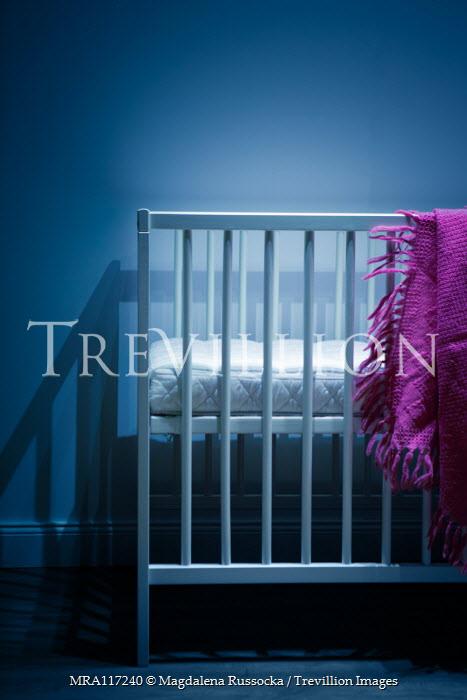 Magdalena Russocka empty baby cot at night