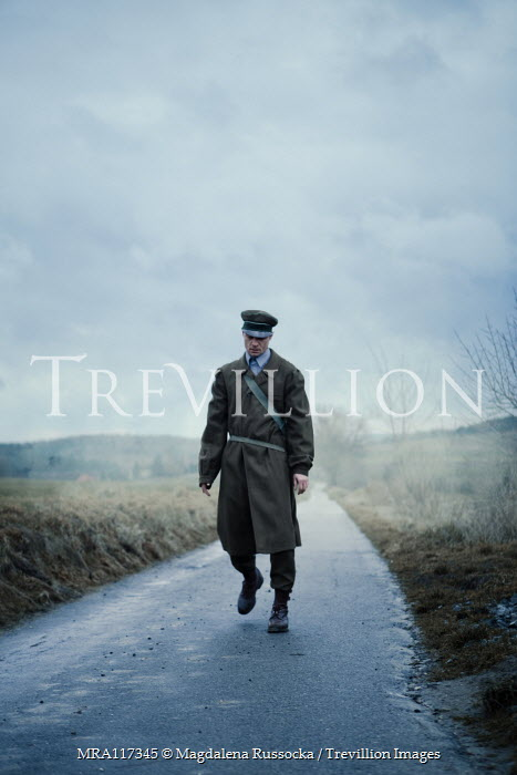Magdalena Russocka soldier in uniform walking on misty country road