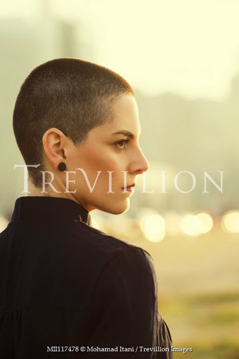 Mohamad Itani CLOSE UP OF WOMAN WITH SHAVEN HEAD OUTDOORS Women