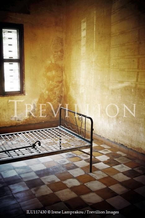 Irene Lamprakou EMPTY METAL BED IN SHABBY ROOM Interiors/Rooms