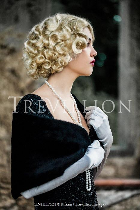 Nikaa Young woman in black fur shawl