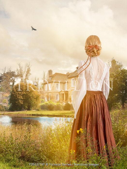 Victoria Davies Victorian woman standing in garden under sunshine