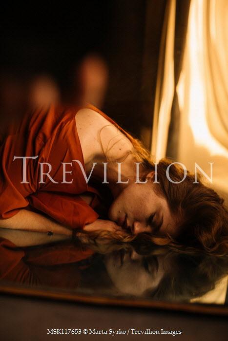 Marta Syrko Woman lying on reflective table
