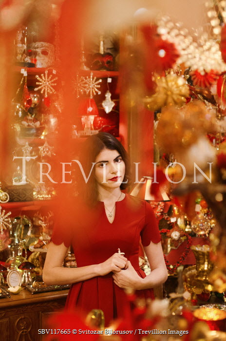 Svitozar Bilorusov Young woman with red dress in store selling Christmas decorations