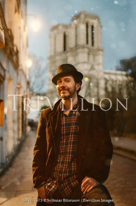 Svitozar Bilorusov Young man in hat and coat on city street