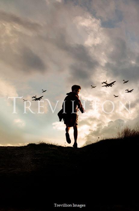 Stephen Mulcahey silhouette of a boy running over a horizon