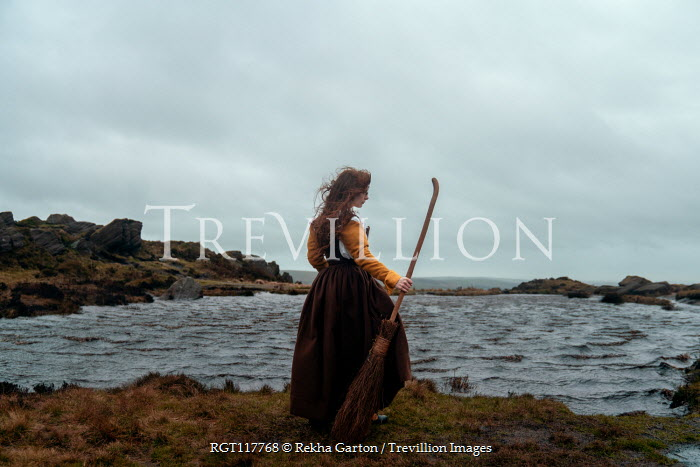 Rekha Garton Witch with broomstick by sea
