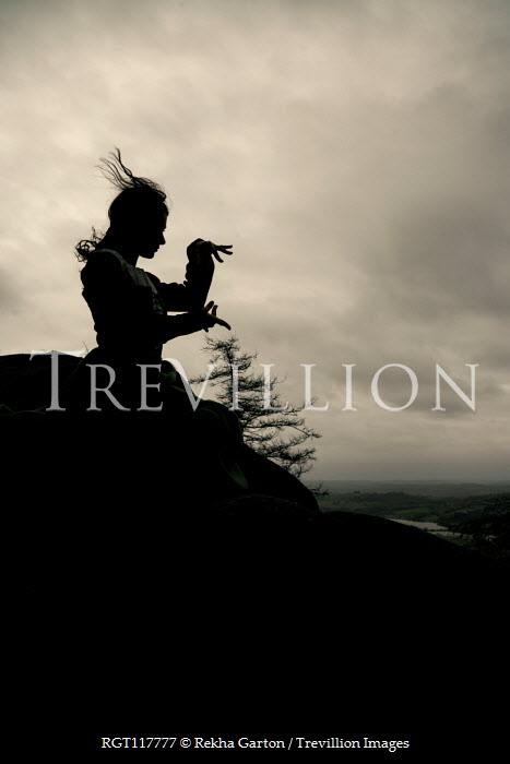 Rekha Garton Witch casting spell on hill