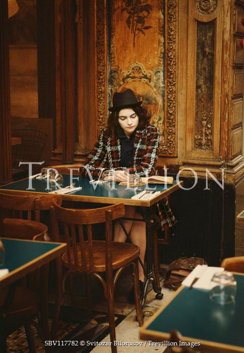 Svitozar Bilorusov Young woman sitting at restaurant table