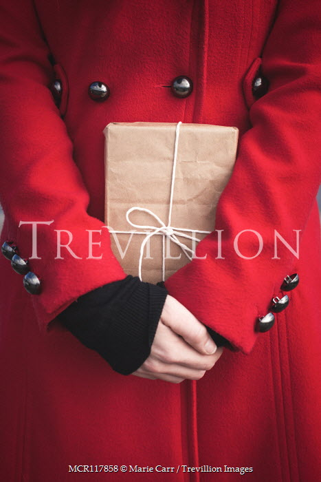 Marie Carr WOMAN IN RED COAT HOLDING PARCEL Women