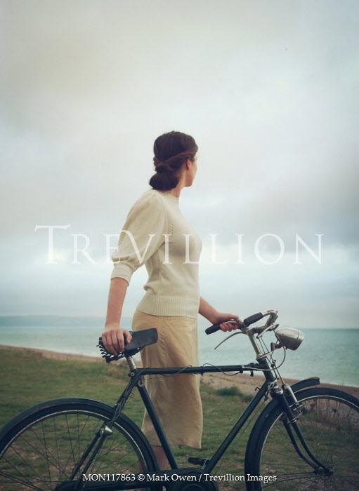 Mark Owen WOMAN WITH BICYCLE WATCHING OCEAN Women