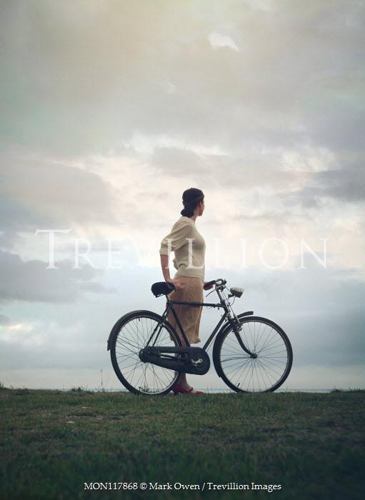 Mark Owen WOMAN WITH BICYCLE WATCHING SEA Women