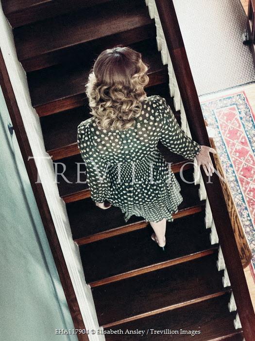 Elisabeth Ansley BLONDE WOMAN IN SPOTTY DRESS ON STAIRCASE Women