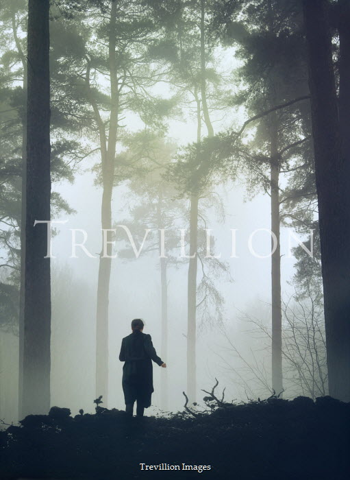 Mark Owen SILHOUETTED WOMAN RUNNING IN FOGGY FOREST Women