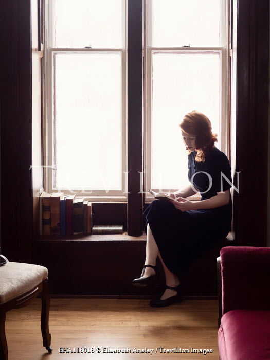 Elisabeth Ansley RETRO WOMAN SITTING READING BY WINDOW Women