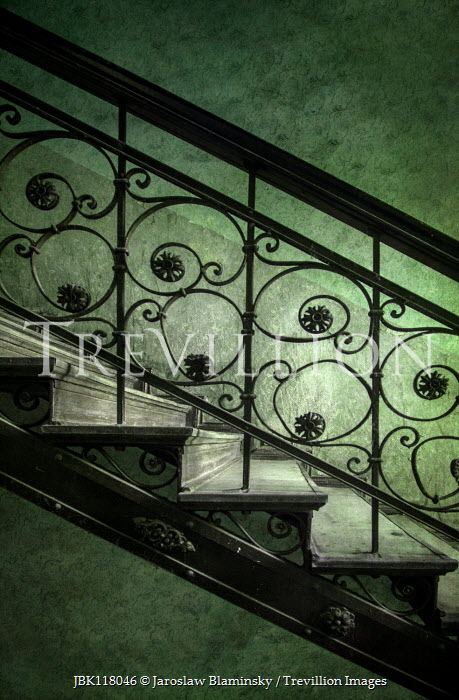 Jaroslaw Blaminsky CLOSE UP OF ORNATE METAL STAIRCASE Stairs/Steps
