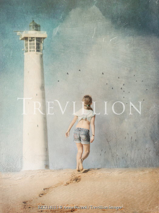 Anna Buczek GIRL IN SHORTS ON BEACH WITH LIGHTHOUSE Children