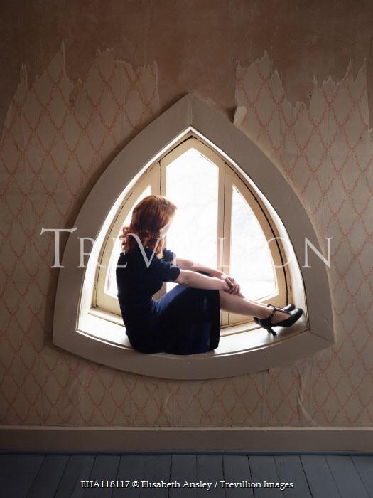 Elisabeth Ansley WOMAN SITTING IN WINDOW WITH PEELING WALLPAPER Women