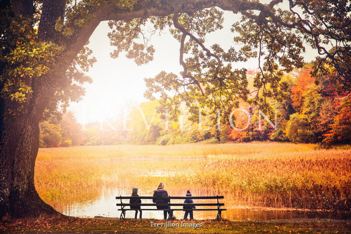 Evelina Kremsdorf MOTHER AND CHILDREN ON BENCH BY SUNLIT LAKE Groups/Crowds