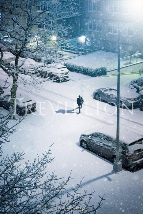 Evelina Kremsdorf MAN RUNNING IN SNOWY STREET IN CITY Men