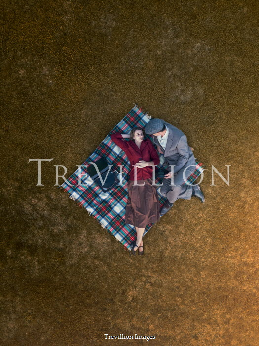 Mary Wethey COUPLE LYING ON TARTAN RUN WITH GRAMOPHONE FROM ABOVE Couples