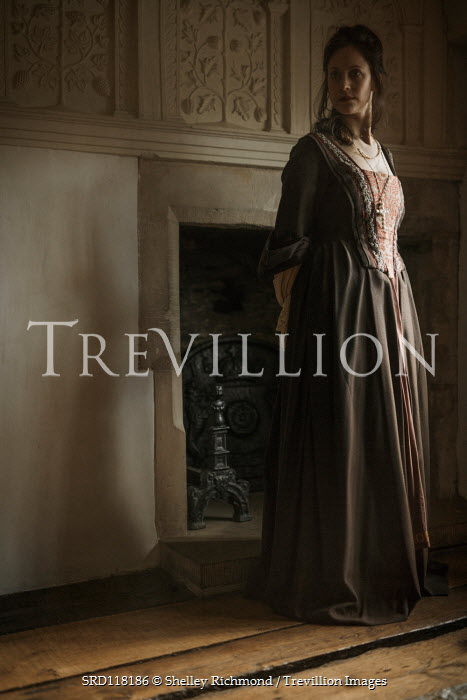 Shelley Richmond HISTORICAL WOMAN STANDING BY FIREPLACE INDOORS Men