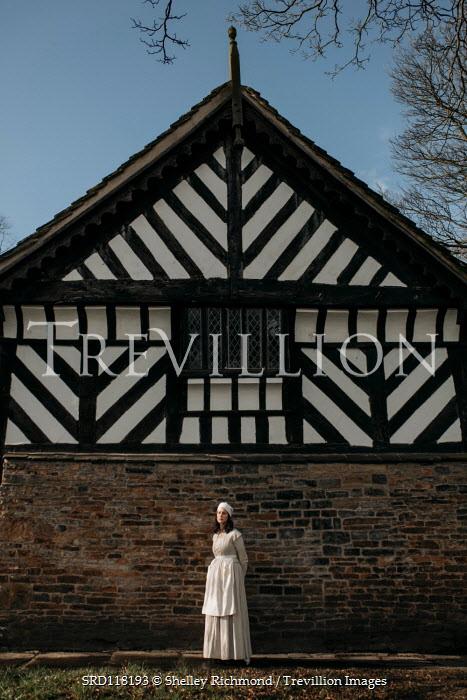 Shelley Richmond SERVANT WOMAN STANDING BY TUDOR HOUSE Women