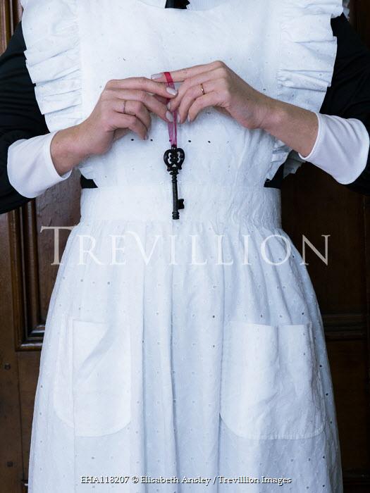 Elisabeth Ansley Maid holding key with red ribbon