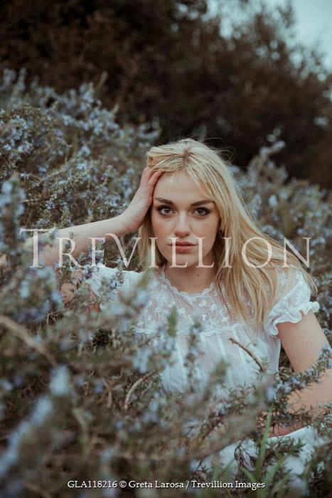 Greta Larosa Young woman sitting in bush