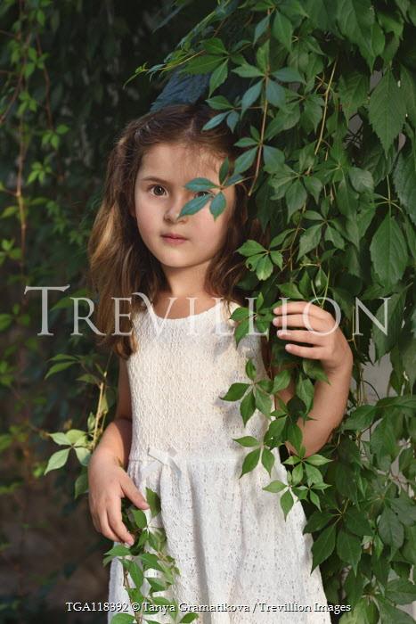 Tanya Gramatikova Girl behind branches of tree