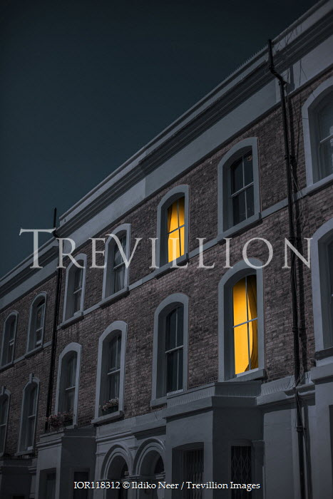 Ildiko Neer Light in windows of houses at evening