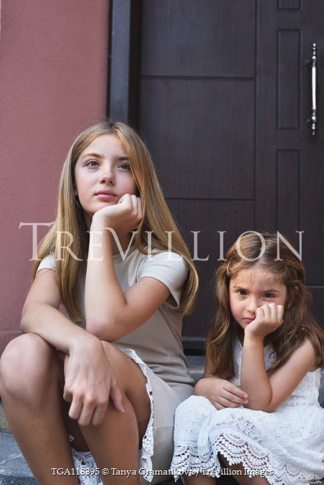 Tanya Gramatikova YOUNG SISTERS SITTING ON STEPS OUTSIDE Children