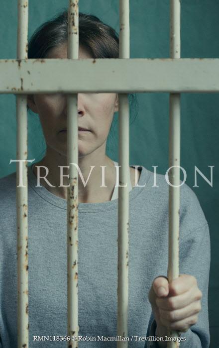 Robin Macmillan Female prisoner behind bars Women