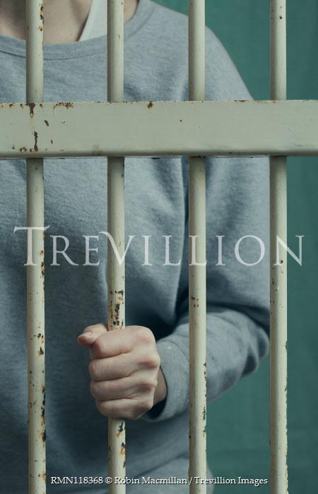 Robin Macmillan Female prisoner behind bars