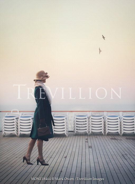 Mark Owen WOMAN WALKING ON DECK OF SHIP WATCHING SEA Women