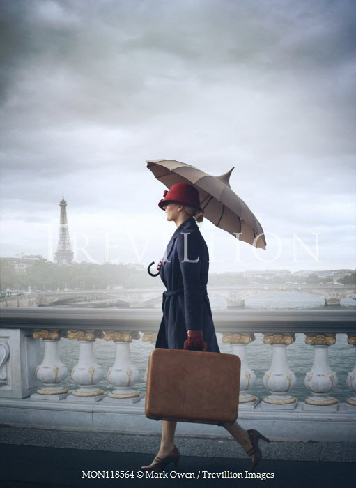 Mark Owen WOMAN WITH UMBRELLA CARRYING SUITCASE IN PARIS Women