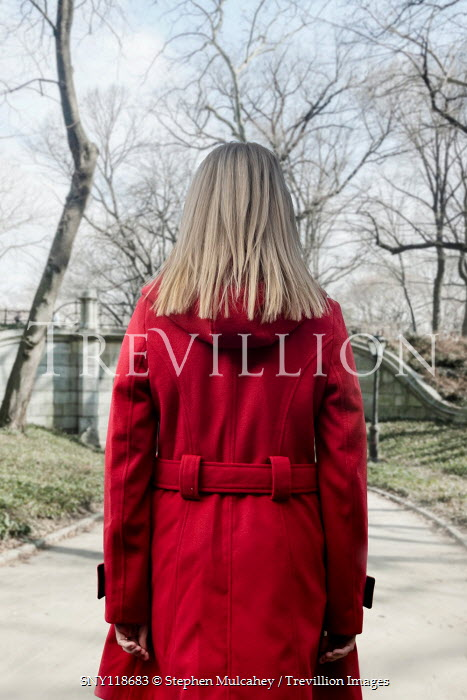 Stephen Mulcahey BLONDE WOMAN IN RED COAT IN CITY PARK Women