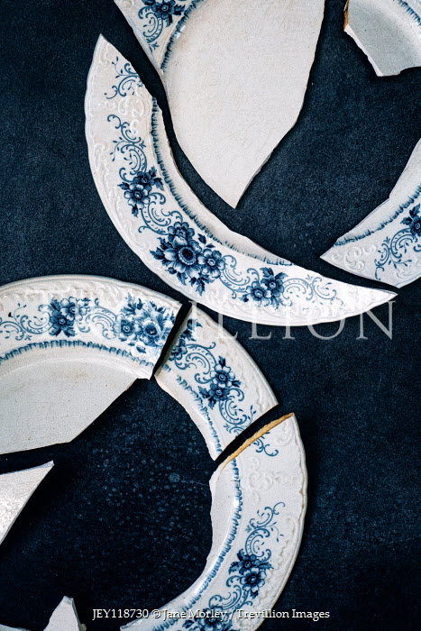 Jane Morley CLOSE UP OF BROKEN BLUE AND WHITE PLATES Miscellaneous Objects