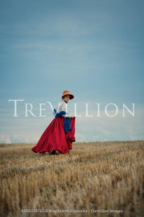 Magdalena Russocka historical woman walking in countryside