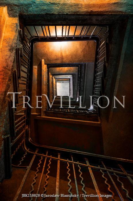 Jaroslaw Blaminsky OLD TALL METAL STAIRCASE FROM BELOW Stairs/Steps